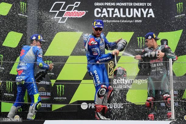 Petronas Yamaha SRT's French rider Fabio Quartararo celebrates his victory on the podium with second placed Suzuki Ecstar's Spanish rider Joan Mir...