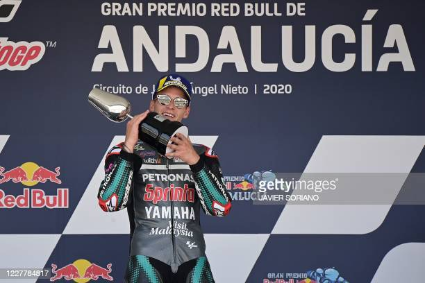 Petronas Yamaha SRT's French rider Fabio Quartararo celebrates on the podium after winning the MotoGP race during the Andalucia Grand Prix at the...