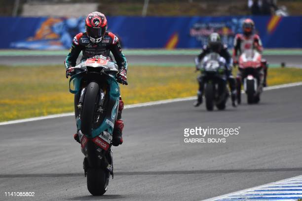 TOPSHOT Petronas Yamaha SRT's French rider Fabio Quartararo does a wheelie to celebrate earning the pole position for tomorrow's race during the...