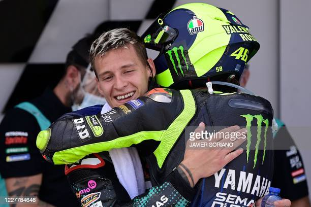 Petronas Yamaha SRT's French rider Fabio Quartararo is congratulated by Monster Energy Yamaha's Italian rider Valentino Rossi after winning the...