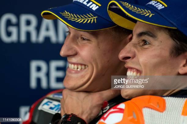 Petronas Yamaha SRT's French rider Fabio Quartararo jokes with third placed Repsol Honda Team's Spanish rider Marc Marquez as he celebrates after...