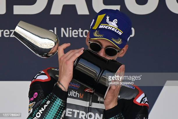 Petronas Yamaha SRT's French rider Fabio Quartararo kisses his trophy as he celebrates on the podium after winning the MotoGP race during the...