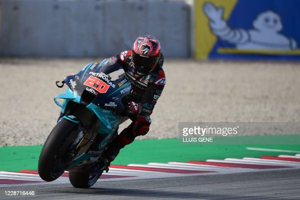 Petronas Yamaha SRT's French rider Fabio Quartararo rides during the third MotoGP free practice session of the Moto Grand Prix de Catalunya at the...