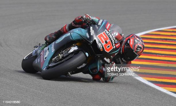 TOPSHOT Petronas Yamaha SRT's French rider Fabio Quartararo steers his bike during the Moto GP free practice session for the Grand Prix of Germany on...
