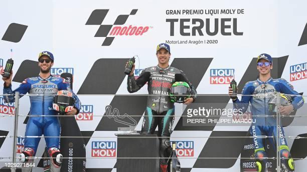 Petronas Yamaha SRT's Italian rider and winner Franco Morbidelli celebrates on the podium with Suzuki Ecstar's second-placed Spanish rider Alex Rins...