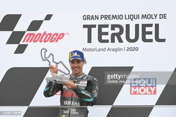 Petronas Yamaha SRT's Italian rider and winner Franco Morbidelli celebrates on the podium after the MotoGP Grand Prix of Teruel at the Motorland...