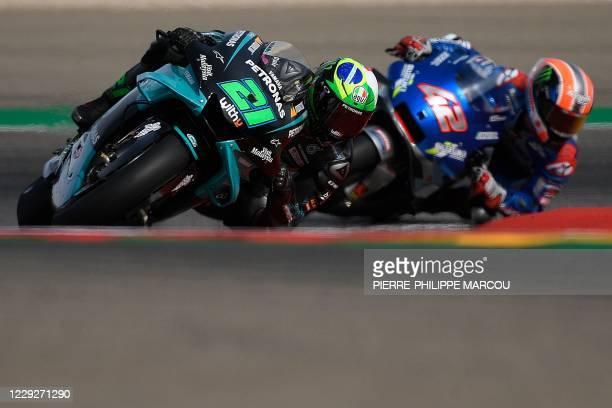 Petronas Yamaha SRT's Italian rider Franco Morbidelli and Suzuki Ecstar's Spanish rider Alex Rins compete in the MotoGP Grand Prix of Teruel at the...