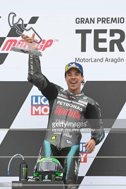 Petronas Yamaha SRT's Italian rider Franco Morbidelli celebrates on the podium after winning the MotoGP Grand Prix of Teruel at the Motorland circuit...