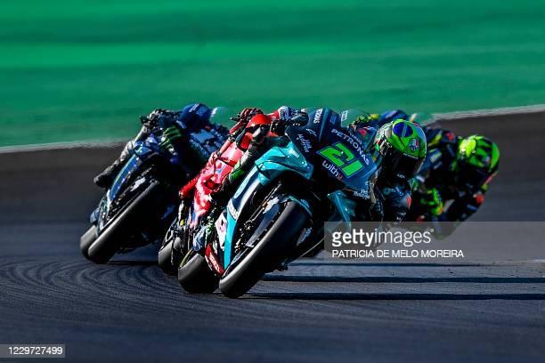 Petronas Yamaha SRT's Italian rider Franco Morbidelli , Monster Energy Yamaha's Spanish rider Maverick Vinales and Monster Energy Yamaha's Italian...