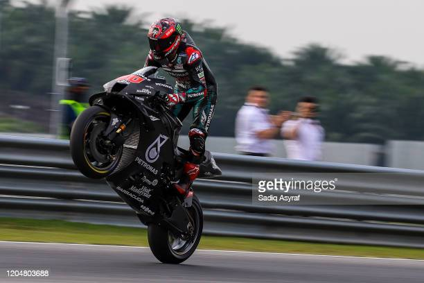 Petronas Yamaha SRTtFrench rider Fabio Quartararo lifts the front wheel during the MotoGP preseason test at Sepang International Circuit on February...