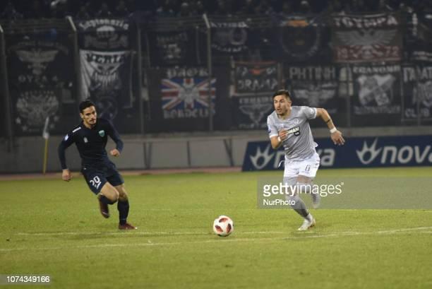 Petros Giakoumaks of Levadeiakos vies Alin Toca of PAOK during Greece Super League Football match between APO Levadeiakos and PAOK Thessaloniki in...