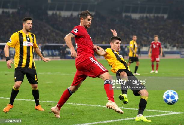 Petros Mantalos of AEK Athens is challenged by Javier Martinez of Bayern Munich during the Group E match of the UEFA Champions League between AEK...