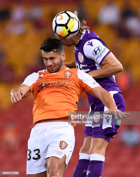 Petros Skapetis of the Roar and Joseph Mills of the Glory challenge for the ball during the round 11 ALeague match between the Brisbane Roar and the...