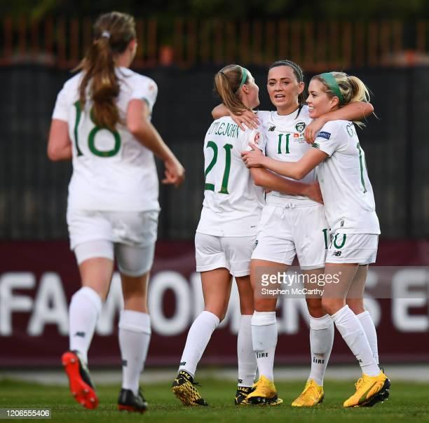 Petrovac Montenegro 11 March 2020 Katie McCabe of Republic of Ireland celebrates with teammates Ruesha Littlejohn left and Denise O'Sullivan right...