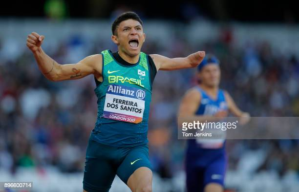 Petrucio Ferreira dos Santos of Brazil celebrates winning gold in a world record in the men's 200m T47 final during the World Para Athletics...