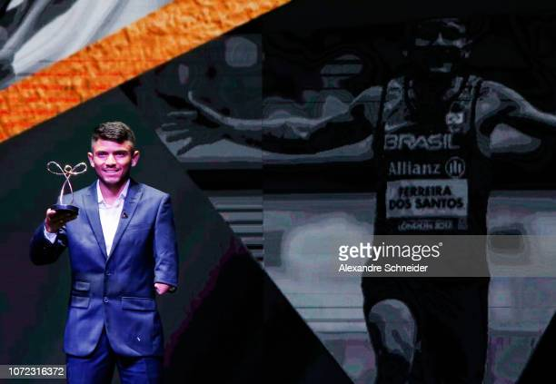 Petrucio Ferreira paralympic runner poses for photo after winning the best athletics athlete during the Brazil Paralympics Awards Ceremony 2018 at...