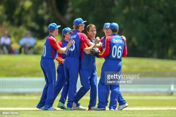 Petrus Burger of Namibia is mobbed by team mates after dismissing Pranav Sharma of Canada for 8 runs during the ICC U19 Cricket World Cup match...