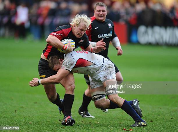 Petrus Du Plessis of Saracens is tackled by Louis Stanfill of USA during the friendly match between Saracens and USA at the Honourable Artillery...