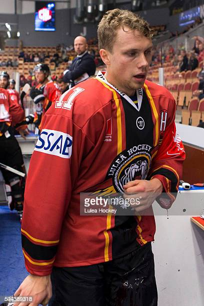 Petter Emanuelsson of Lulea Hockey leaving the ice bleeding from the left wrist during the Champions Hockey League match between Lulea Hockey and...