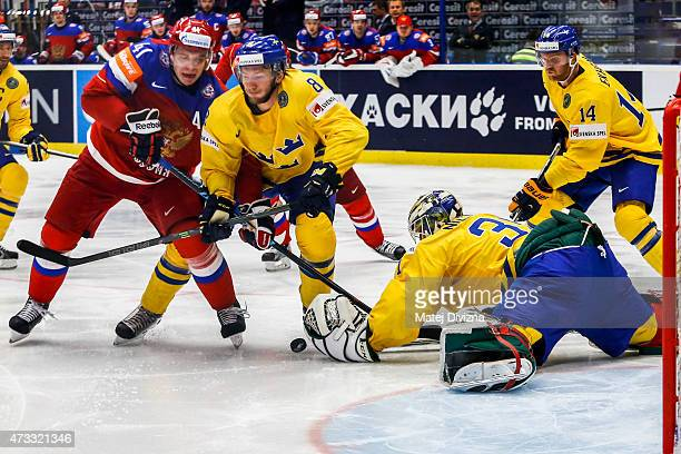 Petter Granberg of Sweden and Yevgeni Malkin of Russia battle for the puck in front of Anders Nilsson goalkeeper of Sweden during the IIHF World...