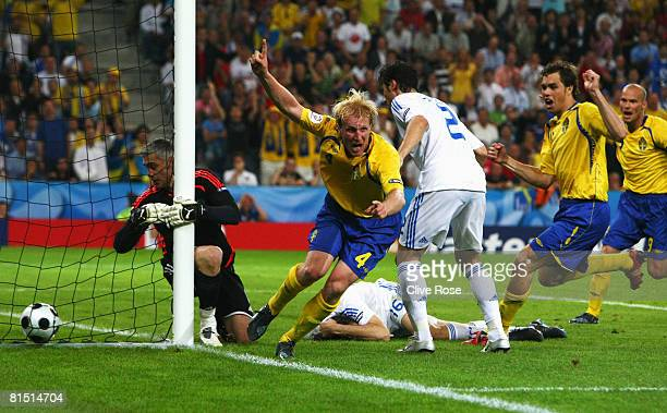 Petter Hansson of Sweden celebrates the Swedish second goal after goalkeeper Antonios Nikopolidis of Greece failed to stop the ball going over the...