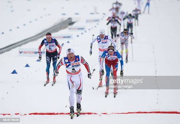 Petter Jr Northug of Norway crosses the line to win the gold medal during the Men's 50km Mass Start CrossCountry during the FIS Nordic World Ski...