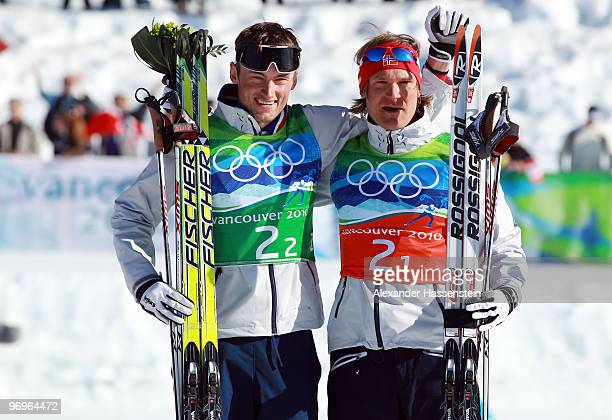 Petter Northug and Oeystein Pettersen of Norway celebrate winning the gold medal during the flower ceremony for the men's team sprint crosscountry...