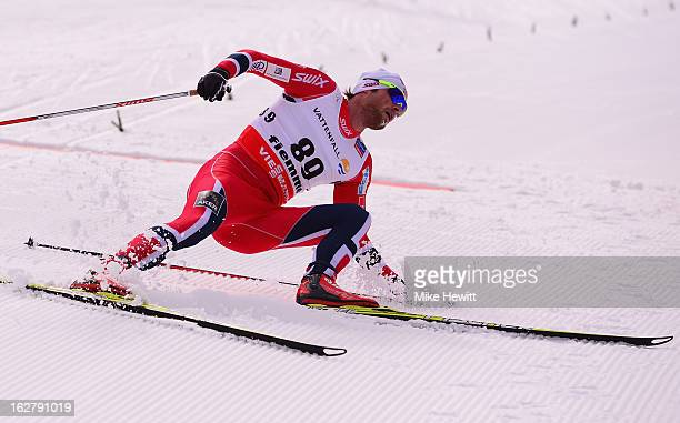 Petter Northug Jr of Norway crosses the line to claim victory in the Men's Cross Country Individual 15km at the FIS Nordic World Ski Championships on...
