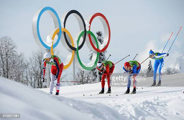 Petter Northug Jr of Norway Gianluca Cologna of Switzerland Ales Razym of the Czech Republic and Dietmar Noeckler of Italy compete in the Men's Team...