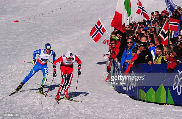 Petter Northug jrof Norway competes with David Hofer of Italy during the Men's Cross Country Relay 4x10 Km at the FIS Nordic World Ski Championships...