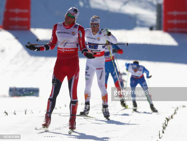 Petter Northug jr.of Norway reacts to securing victory for his team during the Men's Cross Country Relay 4x10 Km at the FIS Nordic World Ski...
