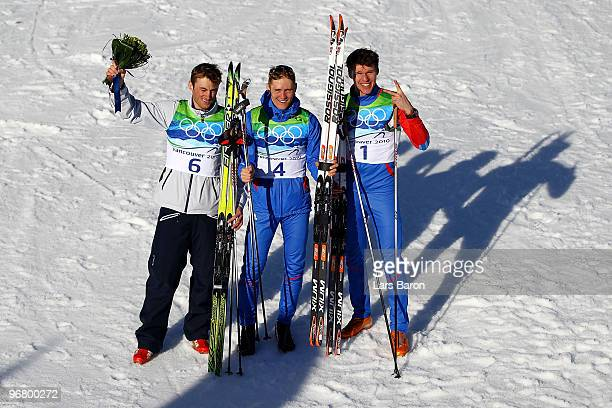 Petter Northug of Norway celebrates winning the bronze medal, Nikita Kriukov of Russia gold and Alexander Panzhinskiy of Russia silver in the Men's...