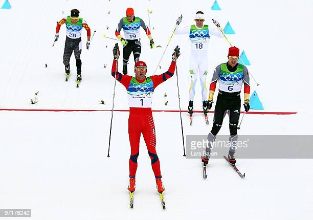 Petter Northug of Norway celebrates winning the gold medal from Axel Teichmann of Germany during the Men's 50 km Mass Start Classic crosscountry...