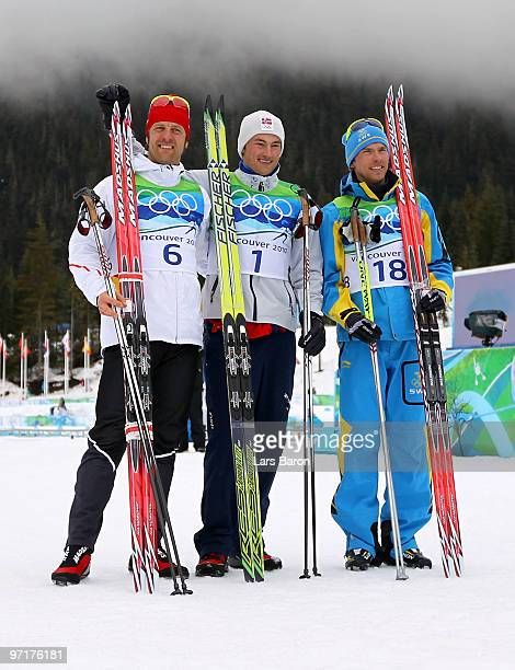Petter Northug of Norway celebrates winning the gold medal with silver medalist Axel Teichmann of Germany and bronze medalist Johan Olsson of Sweden...