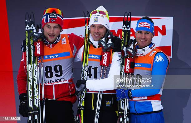 Petter Northug of Norway Johan Olsson of Sweden and Roland Clara of Italy pose on the podium after the mens individual 15km free technic Cross...