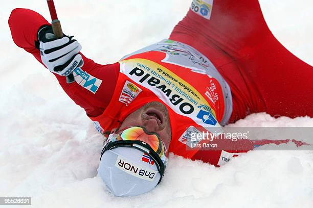 Petter Northug of Norway lies in the snow after winning the Men's 15km Pursuit of the FIS Tour De Ski on January 2 2010 in Oberhof Germany