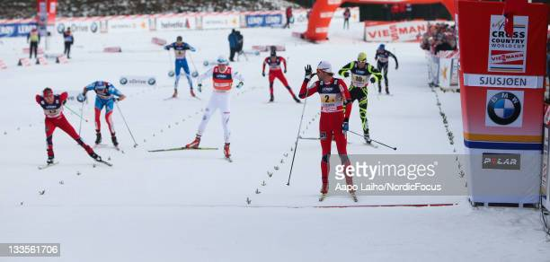 Petter Northug of Norway wins the mass sprint in the men's 4x10km Cross Country Skiing Relay during the FIS World Cup on November 20 in Sjusjoen,...