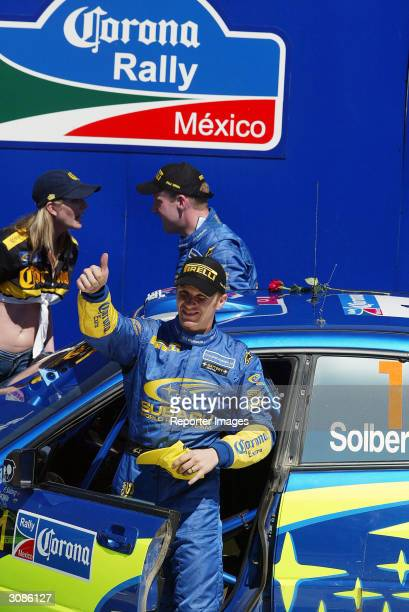 Petter Solberg celebrates on the podium with his Subaru Impreza WRC04 A/8 after his fourth place finish in the Corona Rally Mexico the third round of...