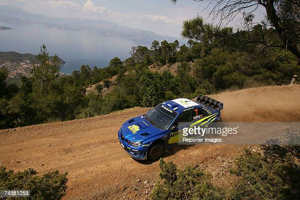 Petter Solberg of Norway and Philip Mills of Great Britain compete in the Subaru Impreza during the second leg of the BP Ultimate Acropolis Rally of...