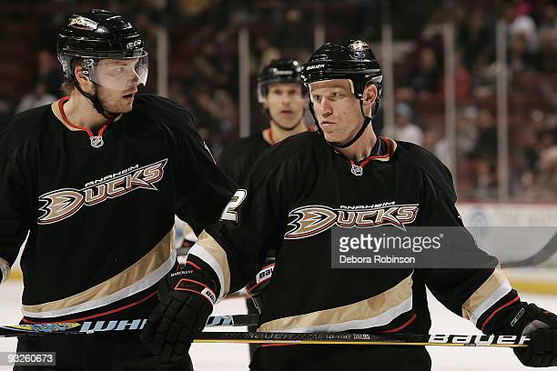Petteri Nokelainen and Todd Marchant of the Anaheim Ducks talk on the ice during the game against the Tampa Bay Lighting on November 19 2009 at Honda...