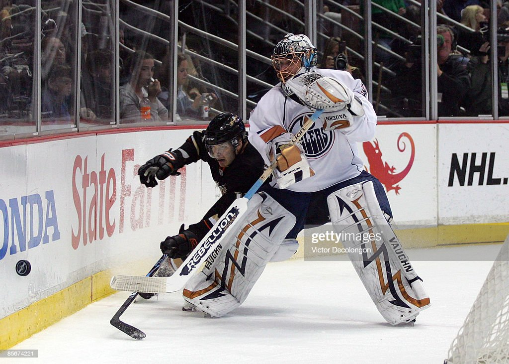 Petteri Nokelainen #17 of the Anaheim Ducks pursues the puck after being played along the boards by goaltender Dwayn Roloson #35 of the Edmonton Oilers during the NHL game at Honda Center on March 27, 2009 in Anaheim, California. The Oilers defeated the Ducks 5-3.