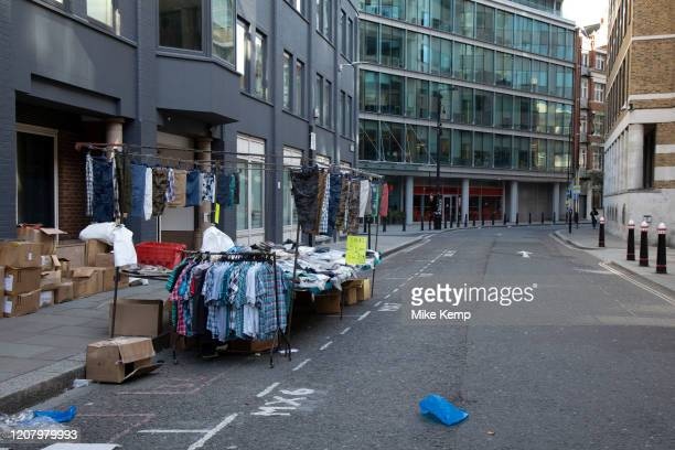 Petticoat Lane Market deserted but with a handful of traders trying to make a few sales due to Covid19 on what would normally be a busy bustling...