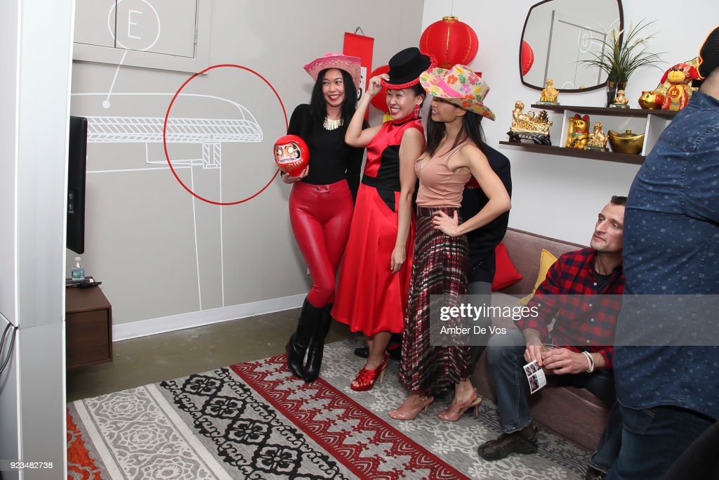 Pettie Chong, Niki Cheng and Min Tan pose in a photobooth at New York Chinese New Year Celebration at Calligaris SoHo on February 13, 2018 in New York City.