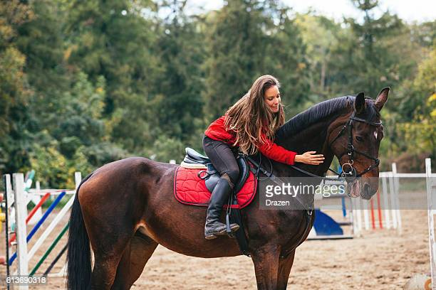 petting and loving a horse - equestrian event stock pictures, royalty-free photos & images