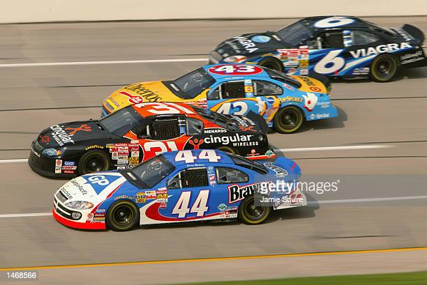 Petty Enterprise drivers Jerry Nadeau and John Andretti race alongside Robby Gordon and Mark Martin during practice for the EA Sports 500 at...
