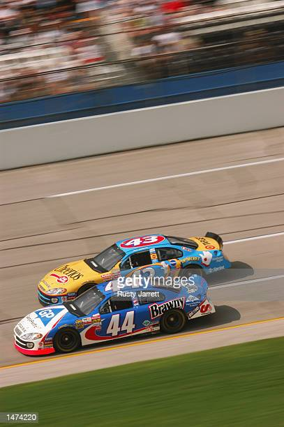Petty Enterprises teammates Jerry Nadeau and John Andretti race alongside each other in their Dodge Intrepid R/ts during practice for the EA Sports...