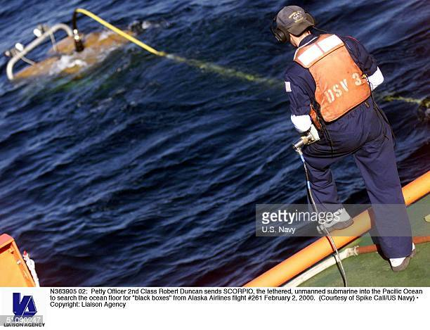 Petty Officer 2Nd Class Robert Duncan Sends Scorpio The Tethered Unmanned Submarine Into The Pacific Ocean To Search The Ocean Floor For 'Black...