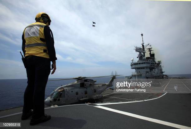 Petty Officer Kirk oversees operations on the flight deck of HMS Ark Royal during Exercise Auriga on July 14 2010 at sea in Onslow Bay near North...