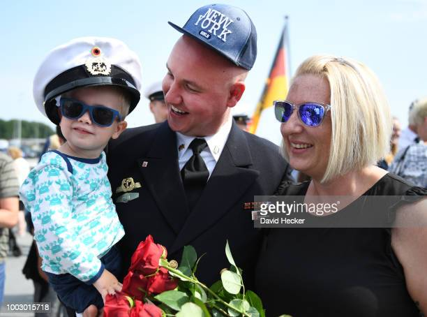 Petty officer second class Reno Ahrens with his son Luis and wife Doreen aboard the Bundeswehr Navy frigate Hessen upon its return to port on July 21...