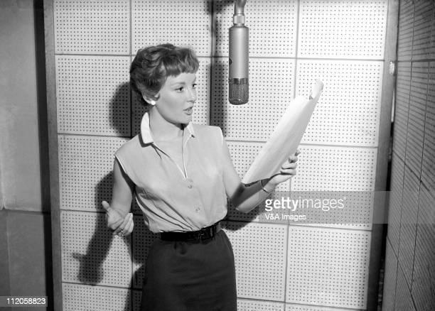 Petula Clark, in recording studio, recording for Pye-Nixa records, 1957.